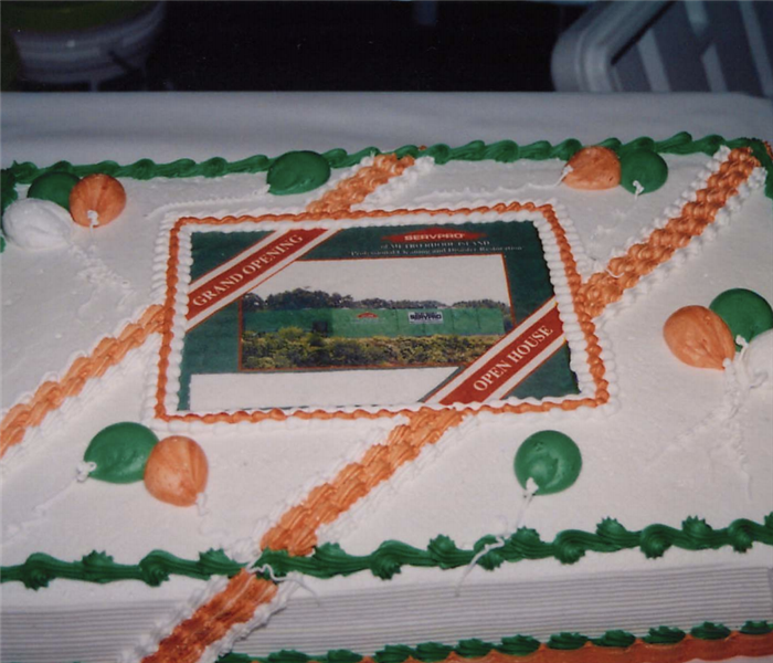 a cake that says grand opening