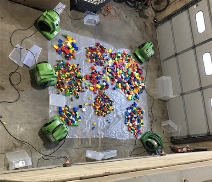 legos surrounded by green drying equipment